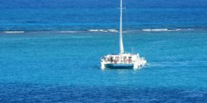 Catamaran boat leaving port